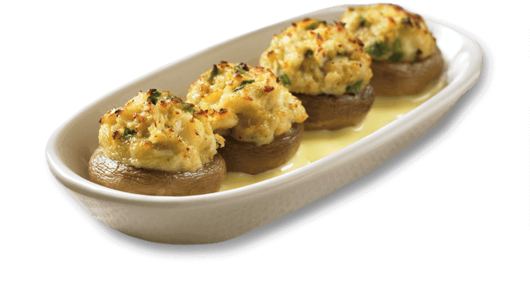 Sautéed mushrooms stuffed with lump crab meat served over a creamy ...